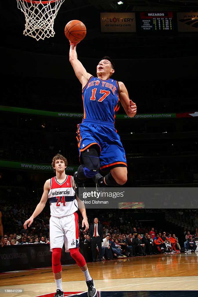 <a gi-track='captionPersonalityLinkClicked' href=/galleries/search?phrase=Jeremy+Lin&family=editorial&specificpeople=6669516 ng-click='$event.stopPropagation()'>Jeremy Lin</a> #17 of the New York Knicks dunks against <a gi-track='captionPersonalityLinkClicked' href=/galleries/search?phrase=Jan+Vesely&family=editorial&specificpeople=5620499 ng-click='$event.stopPropagation()'>Jan Vesely</a> #24 of the Washington Wizards during the game at the Verizon Center on February 8, 2012 in Washington, DC.