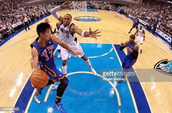Jeremy Lin of the New York Knicks passes the ball against Shawn Marion of the Dallas Mavericks at American Airlines Center on March 6 2012 in Dallas...