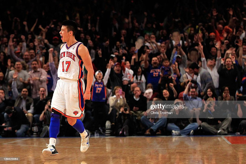 <a gi-track='captionPersonalityLinkClicked' href=/galleries/search?phrase=Jeremy+Lin&family=editorial&specificpeople=6669516 ng-click='$event.stopPropagation()'>Jeremy Lin</a> #17 of the New York Knicks reacts after shooting a three pointer against the Dallas Mavericks at Madison Square Garden on February 19, 2012 in New York City.