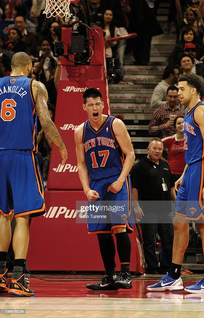 <a gi-track='captionPersonalityLinkClicked' href=/galleries/search?phrase=Jeremy+Lin&family=editorial&specificpeople=6669516 ng-click='$event.stopPropagation()'>Jeremy Lin</a> #14 of the New York Knicks (center) reacts after the final buzzer during the defeat of the Toronto Raptors on February 14, 2012 at the Air Canada Centre in Toronto, Ontario, Canada.