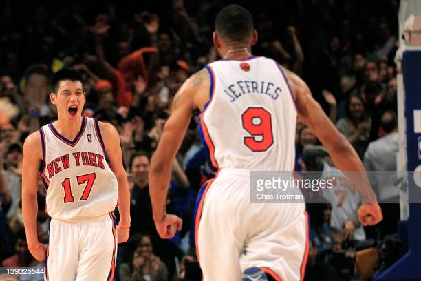Jeremy Lin of the New York Knicks reacts with teammate Jared Jeffries during the game against the Dallas Mavericks at Madison Square Garden on...