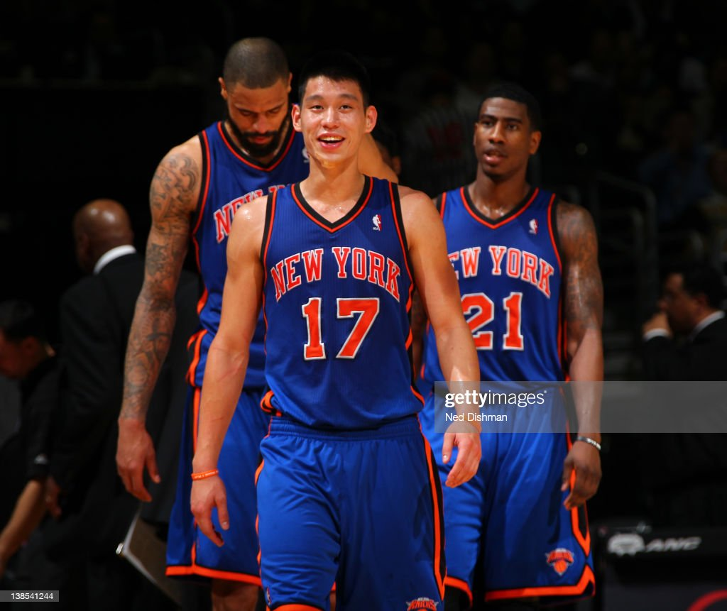 <a gi-track='captionPersonalityLinkClicked' href=/galleries/search?phrase=Jeremy+Lin&family=editorial&specificpeople=6669516 ng-click='$event.stopPropagation()'>Jeremy Lin</a> #17, <a gi-track='captionPersonalityLinkClicked' href=/galleries/search?phrase=Tyson+Chandler&family=editorial&specificpeople=202061 ng-click='$event.stopPropagation()'>Tyson Chandler</a> #6 and <a gi-track='captionPersonalityLinkClicked' href=/galleries/search?phrase=Iman+Shumpert&family=editorial&specificpeople=5042486 ng-click='$event.stopPropagation()'>Iman Shumpert</a> #21 of the New York Knicks enter the court against the Washington Wizards during the game at the Verizon Center on February 8, 2012 in Washington, DC.