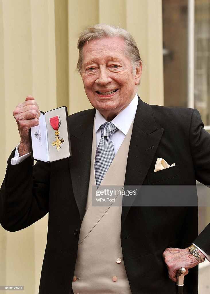 Jeremy Lloyd holds his Officer of the British Empire (OBE) medal after it was presented to him by Queen Elizabeth II at the Investiture Ceremony at Buckingham Palace on February 13, 2012 in London, England.