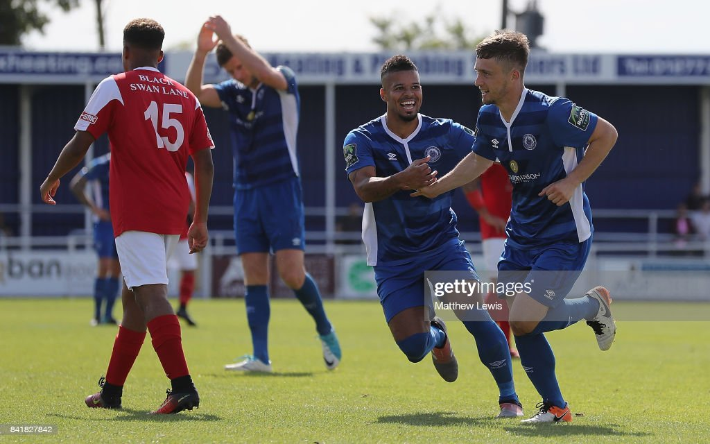 Jeremy Lynch of Billericay Town congratulates Jake Robinson of Billericay Town on his hat trick during The Emirates FA Cup Qualifying First Round match between Billericay Town and Didcot Town on September 2, 2017 in Billericay, England.