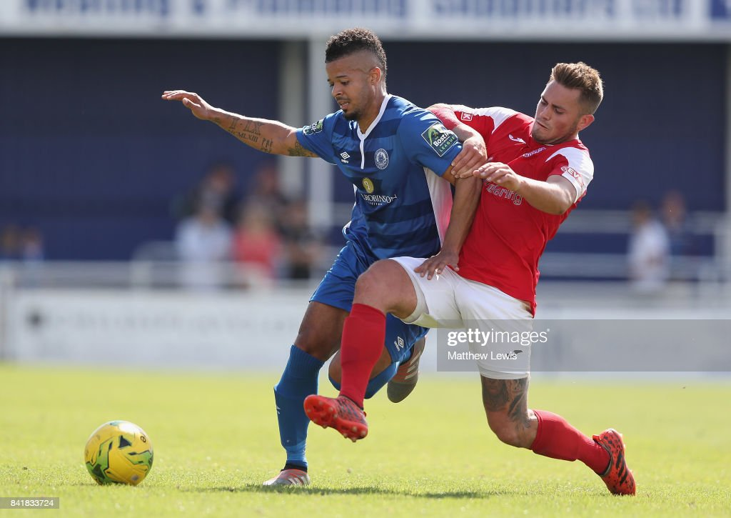 Jeremy Lynch of Billericay Town holds off Adam Learoyd of Didcot Town during The Emirates FA Cup Qualifying First Round match between Billericay Town and Didcot Town on September 2, 2017 in Billericay, England.