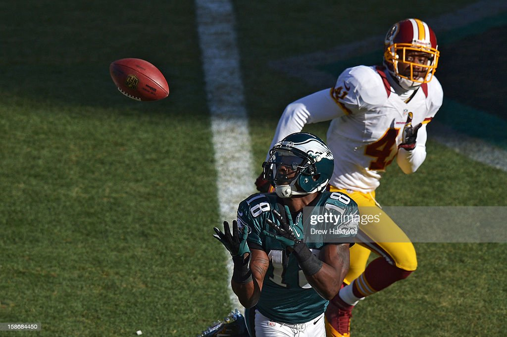 Jeremy Maclin #18 of the Philadelphia Eagles catches a pass for a touchdown in front of Madieu Williams #41 of the Washington Redskins at Lincoln Financial Field on December 23, 2012 in Philadelphia, Pennsylvania. The Redskins won 27-20.