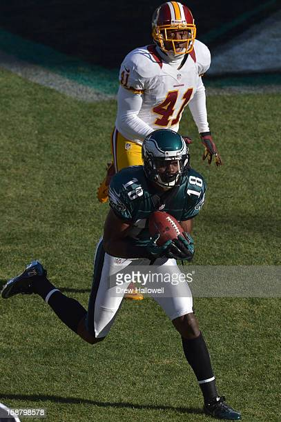 Jeremy Maclin of the Philadelphia Eagles catches a pass for a touchdown in front of Madieu Williams of the Washington Redskins at Lincoln Financial...