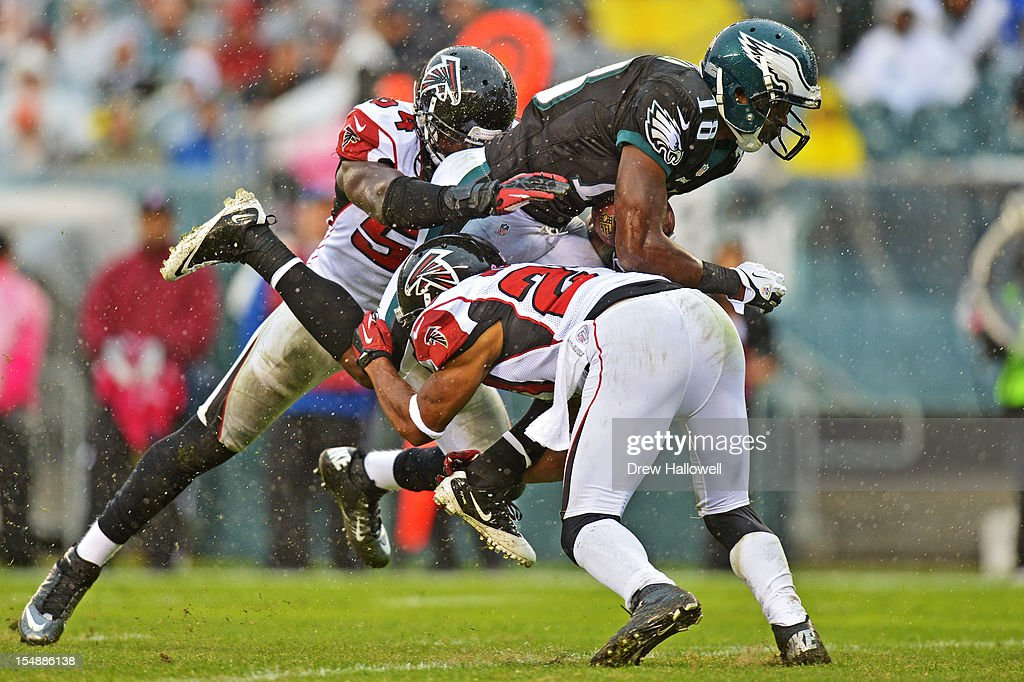 <a gi-track='captionPersonalityLinkClicked' href=/galleries/search?phrase=Jeremy+Maclin&family=editorial&specificpeople=4516851 ng-click='$event.stopPropagation()'>Jeremy Maclin</a> #18 of the Philadelphia Eagles is tackled by Stephen Nicholas #54 and Robert McClain #27 of the Atlanta Falcons at Lincoln Financial Field on October 28, 2012 in Philadelphia, Pennsylvania. The Falcons won 30-17.