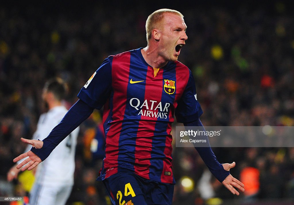 Jeremy Mathieu of Barcelona celebrates as he scores their first goal with a header during the La Liga match between FC Barcelona and Real Madrid CF at Camp Nou on March 22, 2015 in Barcelona, Spain.