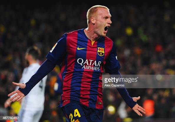 Jeremy Mathieu of Barcelona celebrates as he scores their first goal with a header during the La Liga match between FC Barcelona and Real Madrid CF...