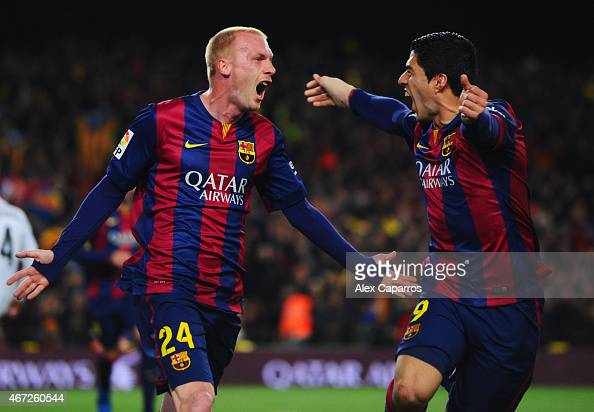 Jeremy Mathieu of Barcelona celebrates with Luis Suarez as he scores their first goal with a header during the La Liga match between FC Barcelona and...