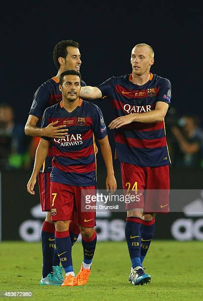Jeremy Mathieu of Barcelona congratulates Pedro of Barcelona on scoring the winning goal during the UEFA Super Cup between Barcelona and Sevilla FC...
