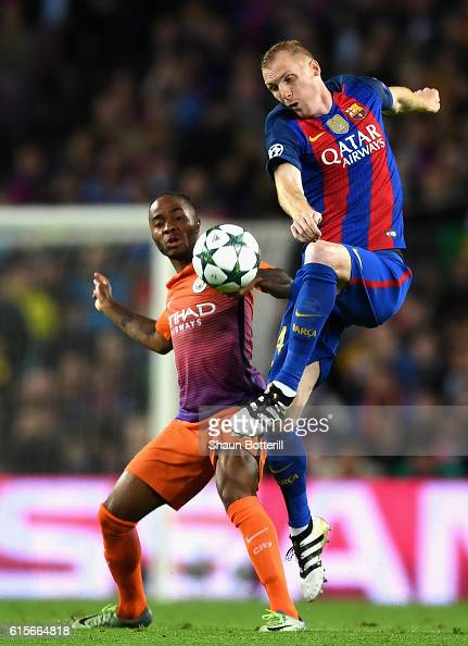 Jeremy Mathieu of Barcelona controls the ball under pressure from Raheem Sterling of Manchester City during the UEFA Champions League group C match...