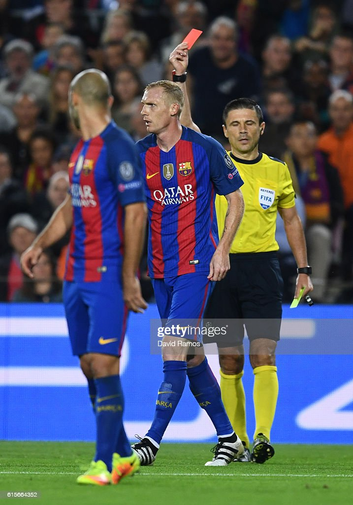 Jeremy Mathieu of Barcelona is sent off by referee Milorad Mažic during the UEFA Champions League group C match between FC Barcelona and Manchester City FC at Camp Nou on October 19, 2016 in Barcelona, Spain.
