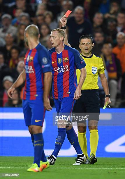 Jeremy Mathieu of Barcelona is sent off by referee Milorad Mažic during the UEFA Champions League group C match between FC Barcelona and Manchester...
