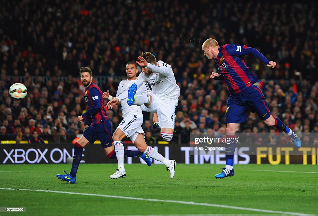 Jeremy Mathieu of Barcelona (R) scores their first goal with a header during the La Liga match between FC Barcelona and Real Madrid CF at Camp Nou on March 22, 2015 in Barcelona, Spain.