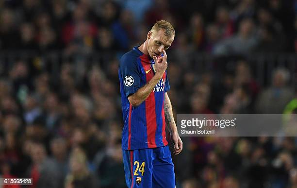 Jeremy Mathieu of Barcelona walks off after being sent off during the UEFA Champions League group C match between FC Barcelona and Manchester City FC...