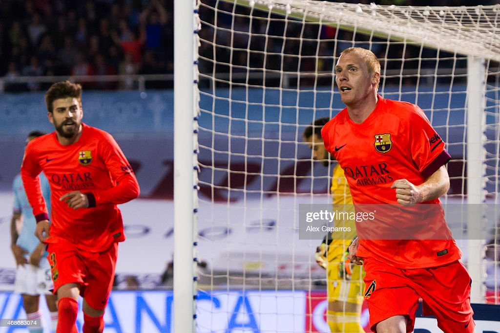 Jeremy Mathieu of FC Barcelona celebrates after scoring the opening goal during the La Liga match between Celta Vigo and FC Barcelona at Estadio Balaidos on April 5, 2015 in Vigo, Spain.