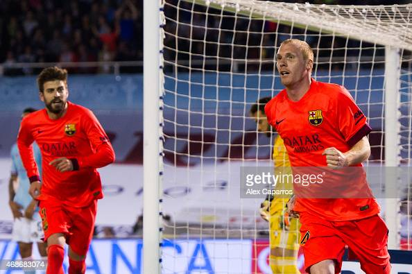 Jeremy Mathieu of FC Barcelona celebrates after scoring the opening goal during the La Liga match between Celta Vigo and FC Barcelona at Estadio...
