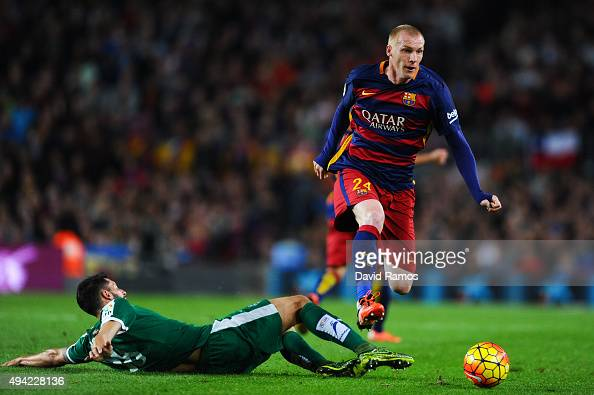 Jeremy Mathieu of FC Barcelona competes for the ball with Mauro Dos Santos of SD Eibar during the La Liga match between FC Barcelona and SD Eibar at...