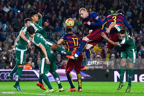Jeremy Mathieu of FC Barcelona competes for the ball with SD Eibar players during the La Liga match between FC Barcelona and SD Eibar at Camp Nou on...
