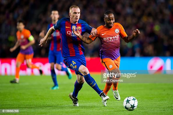 Jeremy Mathieu of FC Barcelona fights for the ball with Raheem Sterling of Manchester City FC during the UEFA Champions League group C match between...