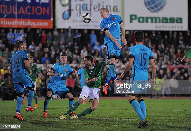 Jeremy Mathieu of FC Barcelona heads the ball during of the Copa del Rey Last of 16 First Leg match between CF Villanovense and FC Barcelona at...