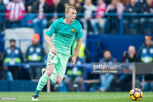 Jeremy Mathieu of FC Barcelona in action during their La Liga match between Atletico de Madrid and FC Barcelona at the Santiago Bernabeu Stadium on...