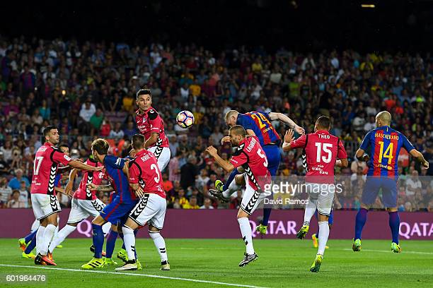 Jeremy Mathieu of FC Barcelona scores his team's first goal during the La Liga match between FC Barcelona and Deportivo Alaves at Camp Nou stadium on...
