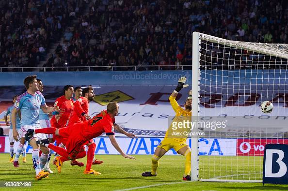 Jeremy Mathieu of FC Barcelona scores the opening goal during the La Liga match between Celta Vigo and FC Barcelona at Estadio Balaidos on April 5...