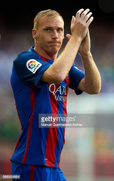 Jeremy Mathieu of FC Barcelona waves during the team official presentation ahead of the Joan Gamper trophy match between FC Barcelona and UC...