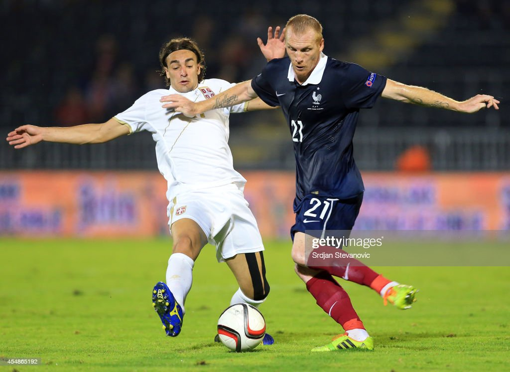 Jeremy Mathieu (R) of France competes for the ball with Lazar Markovic (L) of Serbia during the International friendly match between Serbia and France at the Stadium JNA on September 07, 2014 in Belgrade, Serbia, 2014.