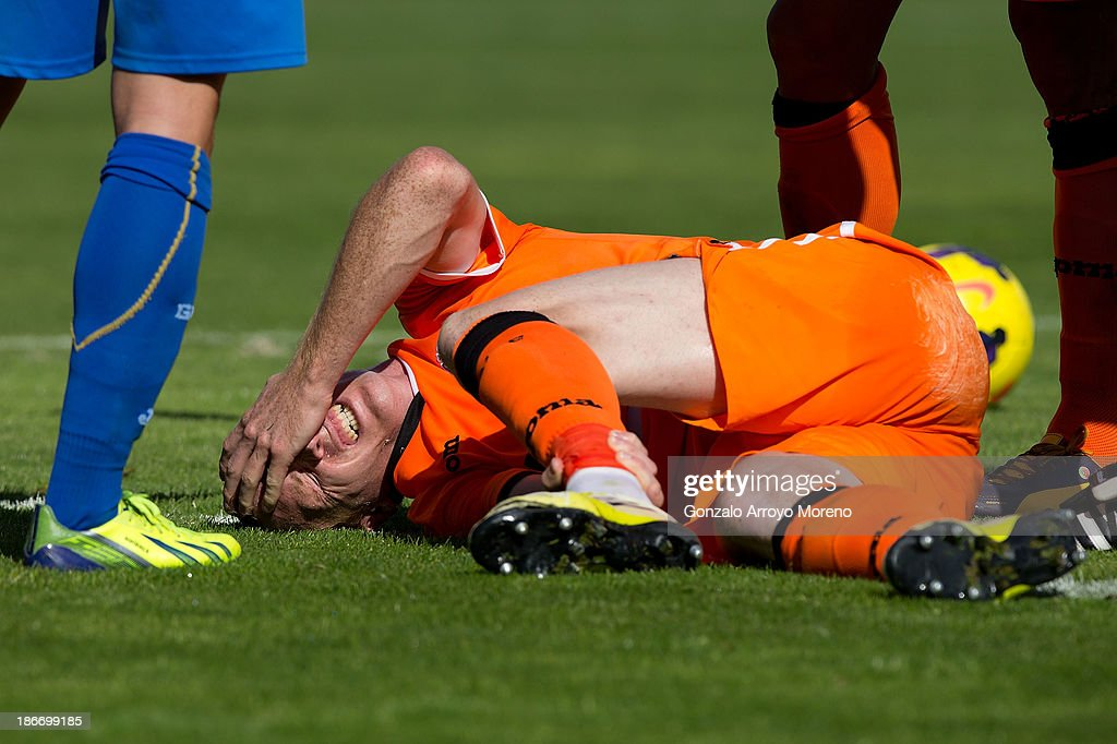 <a gi-track='captionPersonalityLinkClicked' href=/galleries/search?phrase=Jeremy+Mathieu&family=editorial&specificpeople=784387 ng-click='$event.stopPropagation()'>Jeremy Mathieu</a> of Valencia CF grimaces as he lies on the pitch during the La Liga match between Getafe CF and Valencia CF at Coliseum Alfonso Perez on November 3, 2013 in Getafe, Spain.