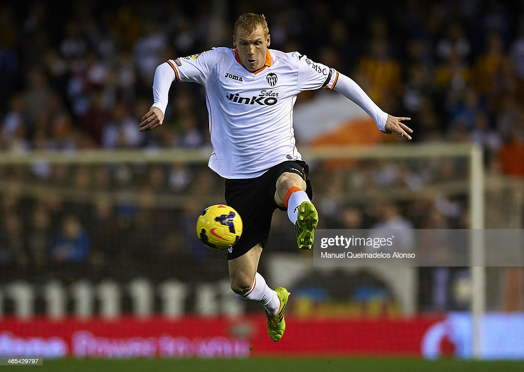 Jeremy Mathieu of Valencia controls the ball during the La Liga match between Valencia CF and RCD Espanyol at Estadio Mestalla on January 25, 2014 in Valencia, Spain.