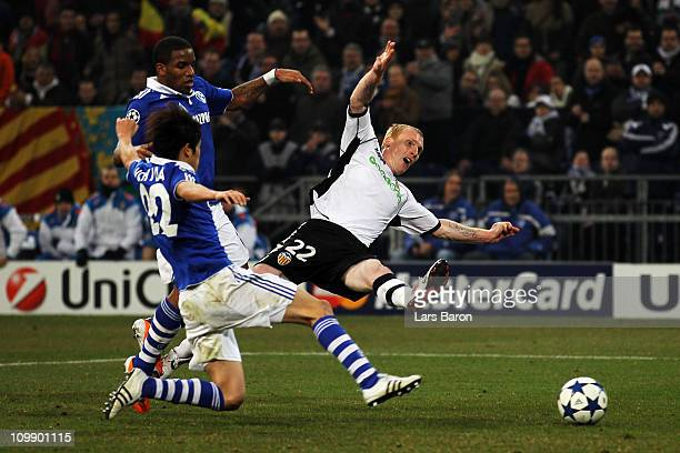 Jeremy Mathieu of Valencia is challenged by Jefferson Farfan of Schalke during the UEFA Champions League round of 16 second leg match between Schalke...