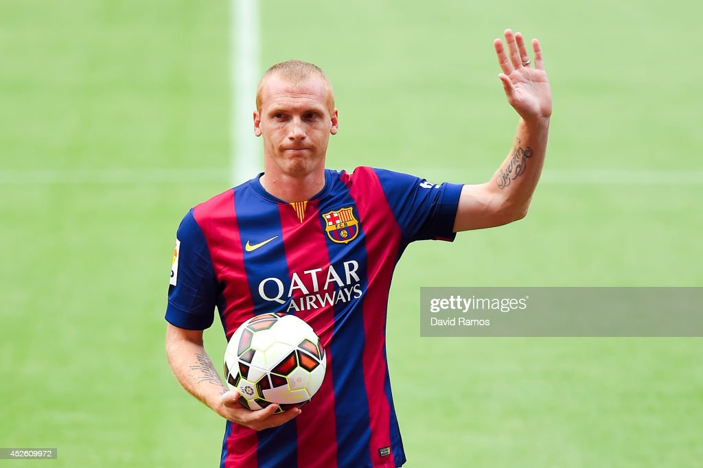 Jeremy Mathieu poses as a new player of FC barcelona at the Camp Nou on July 24, 2014 in Barcelona, Spain.