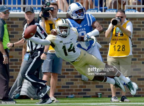 Jeremy McDuffie of the Duke Blue Devils breaks up a pass in the end zone intended for Chris Platt of the Baylor Bears during the game at Wallace Wade...
