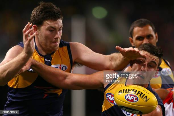 Jeremy McGovern and Elliot Yeo of the Eagles contest for the ball during the round 14 AFL match between the West Coast Eagles and the Melbourne...