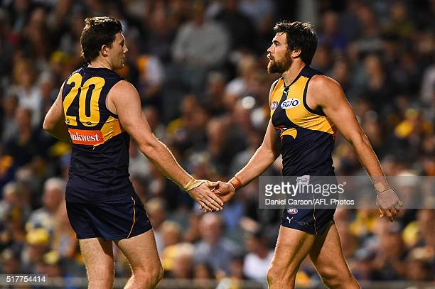 Jeremy McGovern and Josh Kennedy of the Eagles celebrates a goal during the 2016 AFL Round 01 match between the West Coast Eagles and the Brisbane...