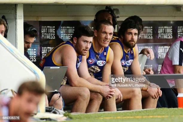 Jeremy McGovern Drew Petrie and Josh Kennedy of the Eagles look on from the bench during the round 10 AFL match between the West Coast Eagles and the...