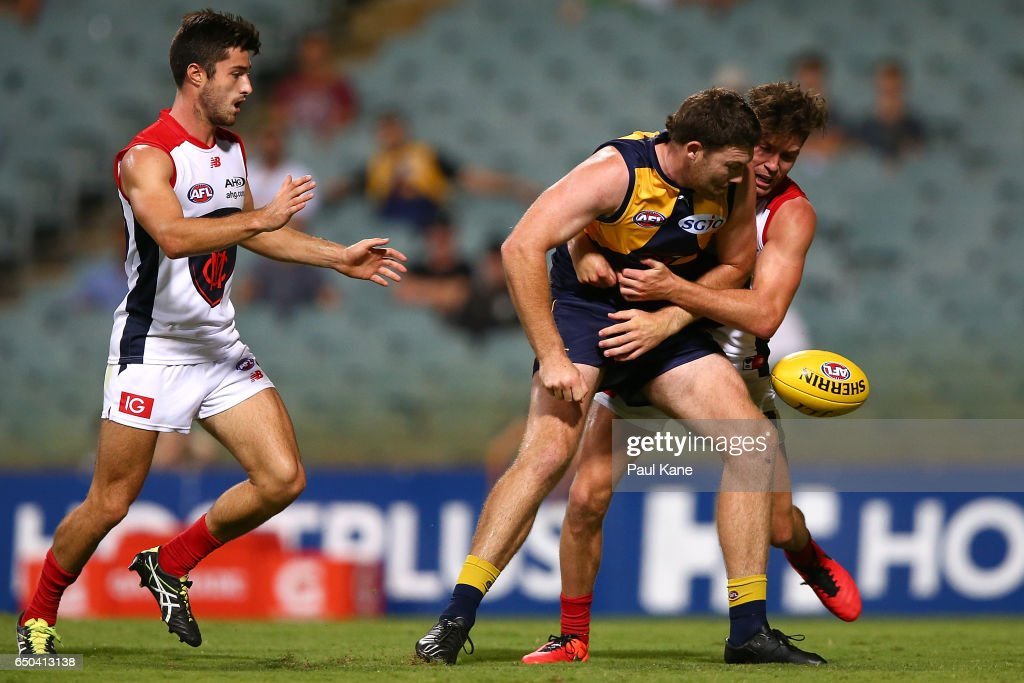 Jeremy McGovern of the Eagles gets tackled by Tomas Bugg of the Demons during the JLT Community Series AFL match between the West Coast Eagles and the Melbourne Demons at Domain Stadium on March 9, 2017 in Perth, Australia.
