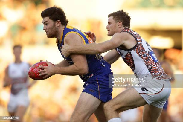 Jeremy McGovern of the Eagles is tackled by Heath Shaw of the Giants during the round 10 AFL match between the West Coast Eagles and the Greater...