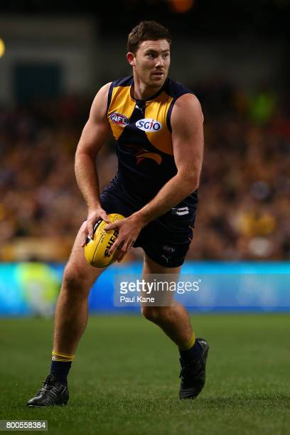 Jeremy McGovern of the Eagles looks to pass the ball during the round 14 AFL match between the West Coast Eagles and the Melbourne Demons at Domain...
