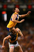 Jeremy McGovern of the Eagles sets for a mark on Jack Riewoldt of the Tigers during the round four AFL match between the West Coast Eagles and the...