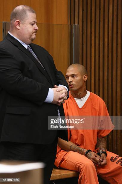 Jeremy Meeks right looks at family members during a court appearance July 8 2014 in Stockton California During his brief appearance the state agreed...
