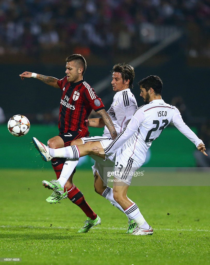 Jeremy Menez of AC Milan battles for the ball with Isco of Real Madrid during the Dubai Football Challenge match between AC Milan and Real Madrid at The Sevens Stadium on December 30, 2014 in Dubai, United Arab Emirates.