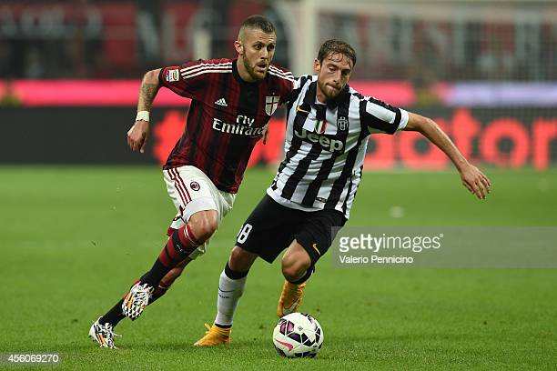 Jeremy Menez of AC Milan in action against Claudio Marchisio of Juventus FC during the Serie A match between AC Milan and Juventus FC at Stadio...