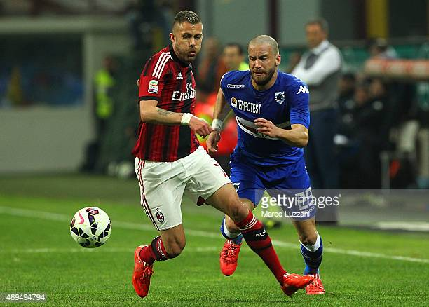 Jeremy Menez of AC Milan is challenged by Lorenzo De Silvestri of UC Sampdoria during the Serie A match between AC Milan and UC Sampdoria at Stadio...