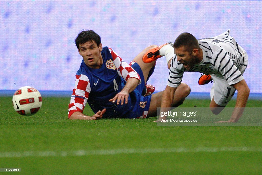 Jeremy Menez of France is tackled by Dejan Lovren of Croatia during the International friendly match between France and Croatia at Stade de France at Stade de France on March 29, 2011 in Paris, France.