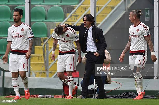 Jeremy Menez of Milan celebrates with head coach Filippo Inzaghi after scoring his team's second goal during the Serie A match between US Citta di...